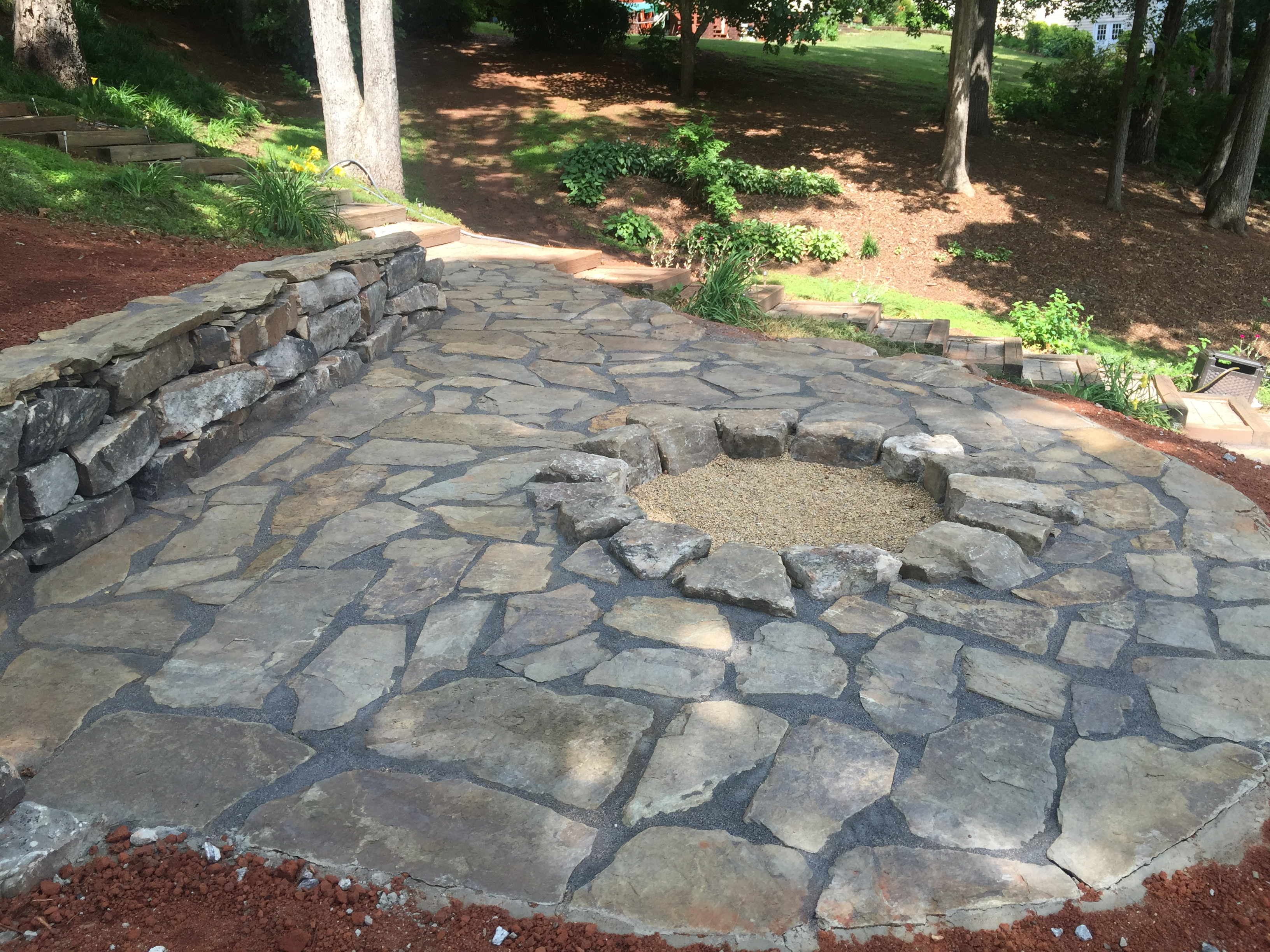 Flagstone patio fire pit installed for seneca customer for Pictures of stone patios